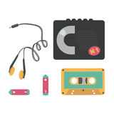 The cassette player with tape, headphones and batteries Royalty Free Stock Photography