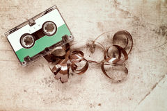 Cassette with pulled out tape on dirty canvas Royalty Free Stock Photos