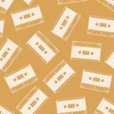 Cassette seamless pattern. Vintage background. Cassette seamless pattern. Vintage orange background Stock Photos