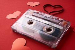Cassette sonore avec la bande magnétique dans la forme du coeur Photographie stock