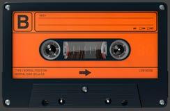 Cassette sonore orange et noire avec l'autocollant et le label photo stock