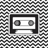 Cassette sticker on pop art zig zag linear monochrome background. Vector illustration Stock Photography