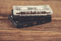 Cassette on table. Music cassette on the wooden table background royalty free stock images
