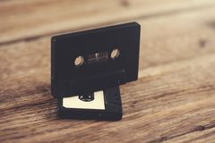 Cassette on table. Music cassette on the wooden table background royalty free stock photography
