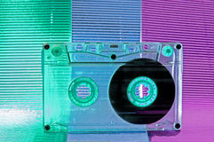 Cassette tape. Transparent Cassette tape. Pink and blue background stock photo