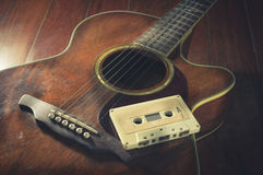Cassette tape on acoustic guitar. Stock Images