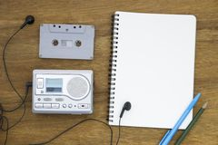 Cassette tape audio player and blank paper vintage still life Royalty Free Stock Photo
