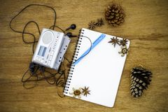 Cassette tape audio player and blank paper vintage still life Royalty Free Stock Image