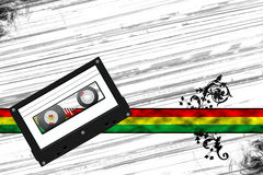 Cassette tape with blank white label on red yellow green banner Stock Photography