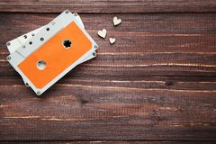 Cassette tape. On brown wooden table royalty free stock images