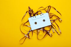 Cassette tape. On yellow background royalty free stock images