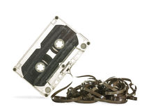 Cassette tape. Damaged audio cassette isolated on white background stock image