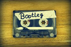 Cassette tape with the description: Bootleg. Vintage audio cassette tape with the description: Bootleg royalty free stock image