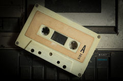 Cassette tape on dusty retro player. Stock Photo