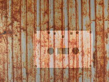 Cassette tape with grunge rusty metal retro background Stock Photography