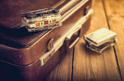 Cassette tape lying on an old suitcase. Royalty Free Stock Photos