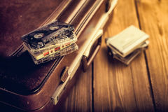 Cassette tape lying on an old suitcase. Royalty Free Stock Images