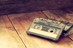 Cassette tape over wooden table. image is instagram style filtered. Stock Photos