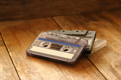 Cassette tape over wooden table. image is instagram style filtered. Royalty Free Stock Photos