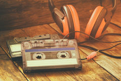 Cassette tape over wooden table. image is instagram style filtered. Stock Photography
