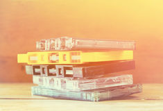 Cassette tape over wooden table with tangled ribbon. top view. retro filter Royalty Free Stock Images