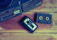 Cassette tape and player vintage color tone. Old cassette tape and player ,vintage style royalty free stock photography