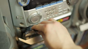Cassette tape into record player stock video footage