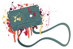 Cassette tape with splattered ink. Music cassette tape with jumbled mess of paint splatters Stock Photos