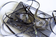 Cassette Tape Unravelled. Generic audio cassette tape. Tape pulled out in a tangled heap. Space for you text royalty free stock images