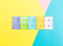 Cassette tapes. On a bright split tone background royalty free stock image