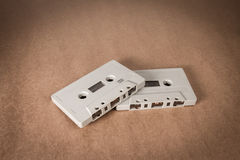 Cassette tapes on brown paper background. Vintage style Royalty Free Stock Images