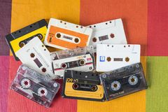 Cassette tapes on a checkered tablecloth