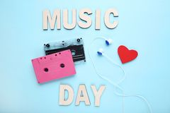 Cassette tapes with earphones. And red heart on blue background royalty free stock photo