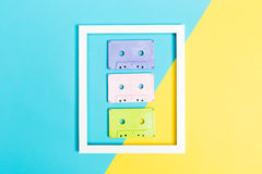 Cassette tapes and frame on split background Royalty Free Stock Photos