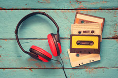 Cassette tapes over blue textured wooden table . top view. retro filter Stock Photos