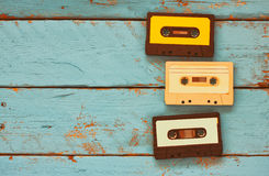 Cassette tapes over blue textured wooden table . top view. retro filter Royalty Free Stock Images