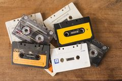 Cassette tapes on a wooden board royalty free stock photo