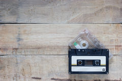 Cassette. Two cassette in Black and clear color on wood background stock photos