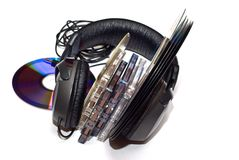 Cassettes, vinyl records, CD and Headphones. Audio cassettes, vinyl records, CD and Headphones on white background Stock Photo