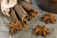 Cassia Bark & Star Anise. Cassia Bark & Star Anise - Close up of cassia bark and star anise on a rustic background Stock Photo