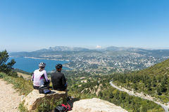 Cassis sea mountain cyclists road stock photography