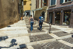 Cassis street steps shops people royalty free stock image
