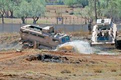 Casspir troop carrier driving through muddy water