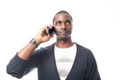 Cassual dressed afro-american man at the phone. Royalty Free Stock Photography