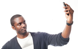 Cassual dressed black man makes a self portrait. Royalty Free Stock Photography