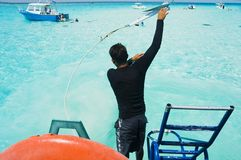 Cast Anchor. A dive boat captain casts anchor at stingray city in the cayman islands Stock Images