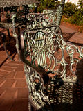 Cast Bronze chairs. Detail of cast bronze chairs in a hotel courtyard in Savannan GA royalty free stock image