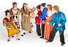 Cast of Characters. A cast of theater characters in costume with Shamans or forest spirits and Russians stock photos