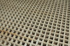 Cast concrete grid horizontal squares with diagonal braces Royalty Free Stock Photography