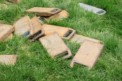 Cast iron Balance weight parts in the lawn Stock Photo